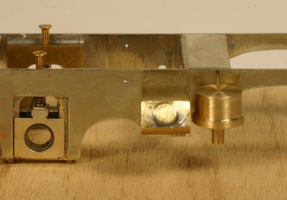 The distinction between the two brass shapes bolted onto the side of the chassis is very clear in this photo. The one on the left was primarily made on my mill, the one of the right on the lathe.